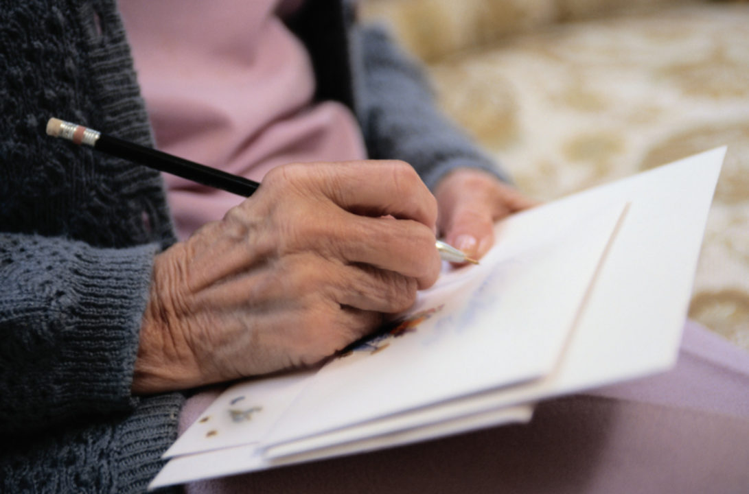 Woman writing a letter by hand