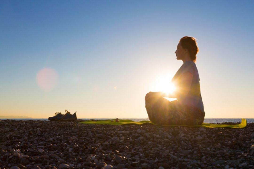 Woman silhouette in meditation