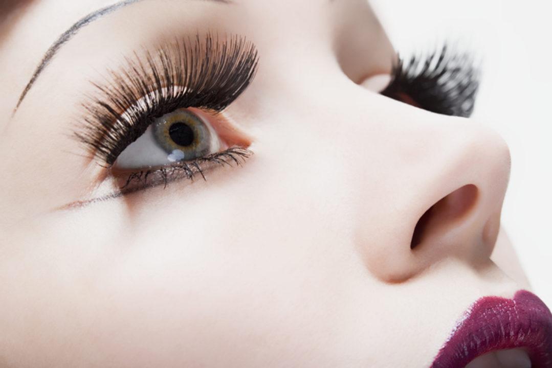 A woman with large fake eyelashes