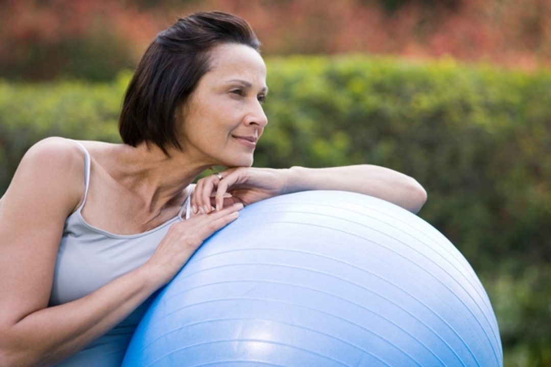 Woman content with exercise ball