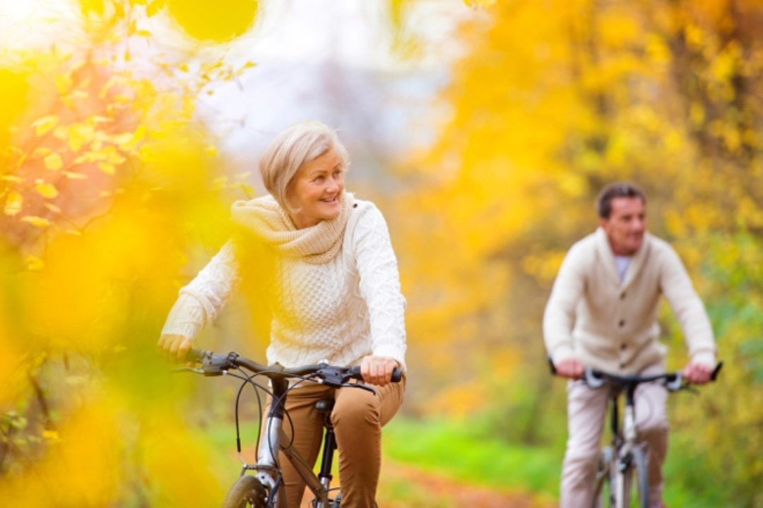 Couple riding bikes in fall
