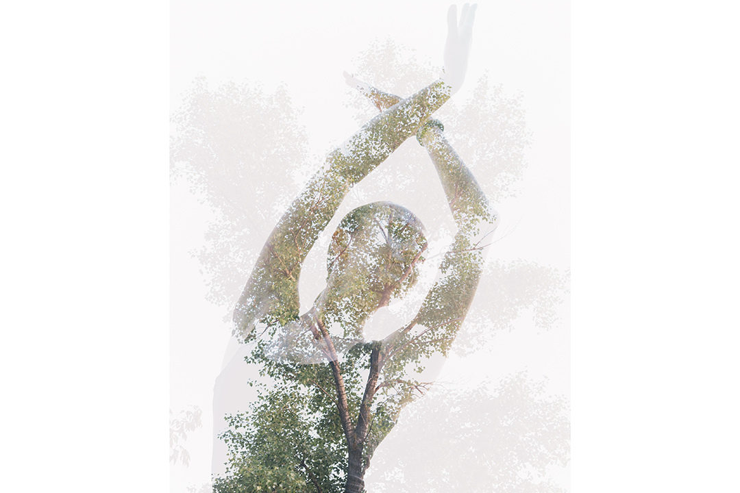 Double exposure of woman moving with tree