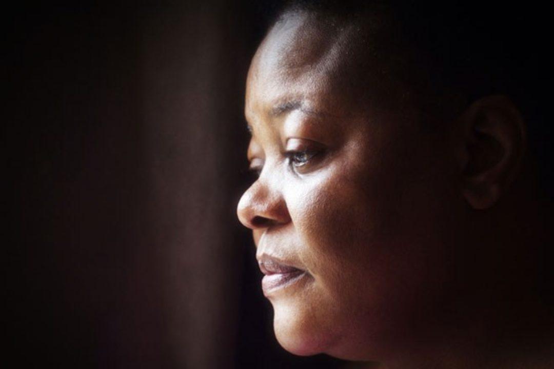 Sad woman looking toward light