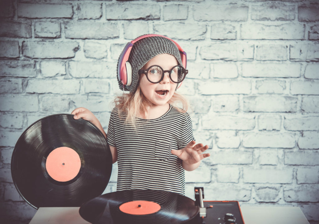 Little girl with pink records playing DJ.