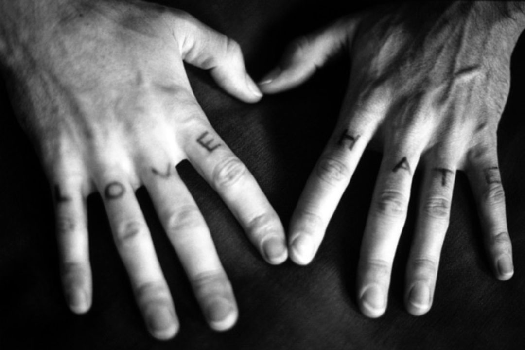 Love Hate tattooed on hands