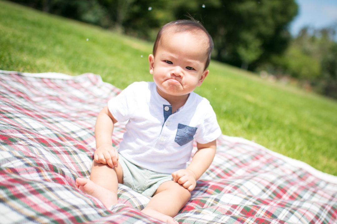 An angry or sad baby looks upset.