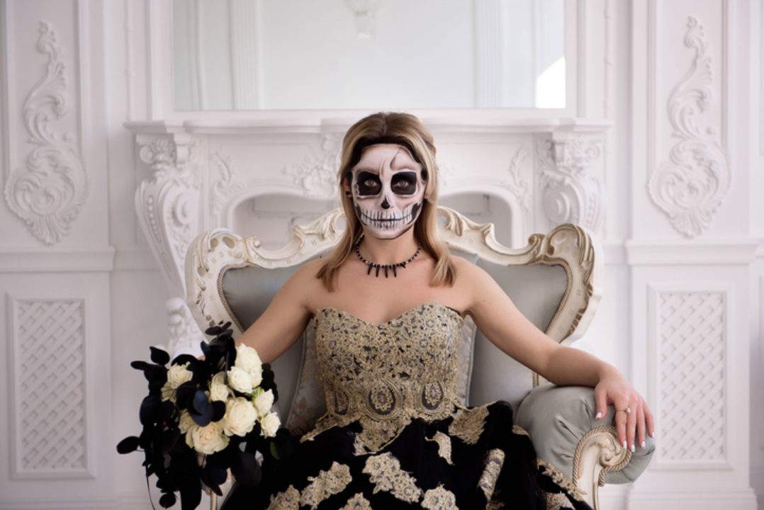 """<img src=""""woman in ghost mask.jpg"""" alt=""""woman wearing Halloween ghost face""""/>"""