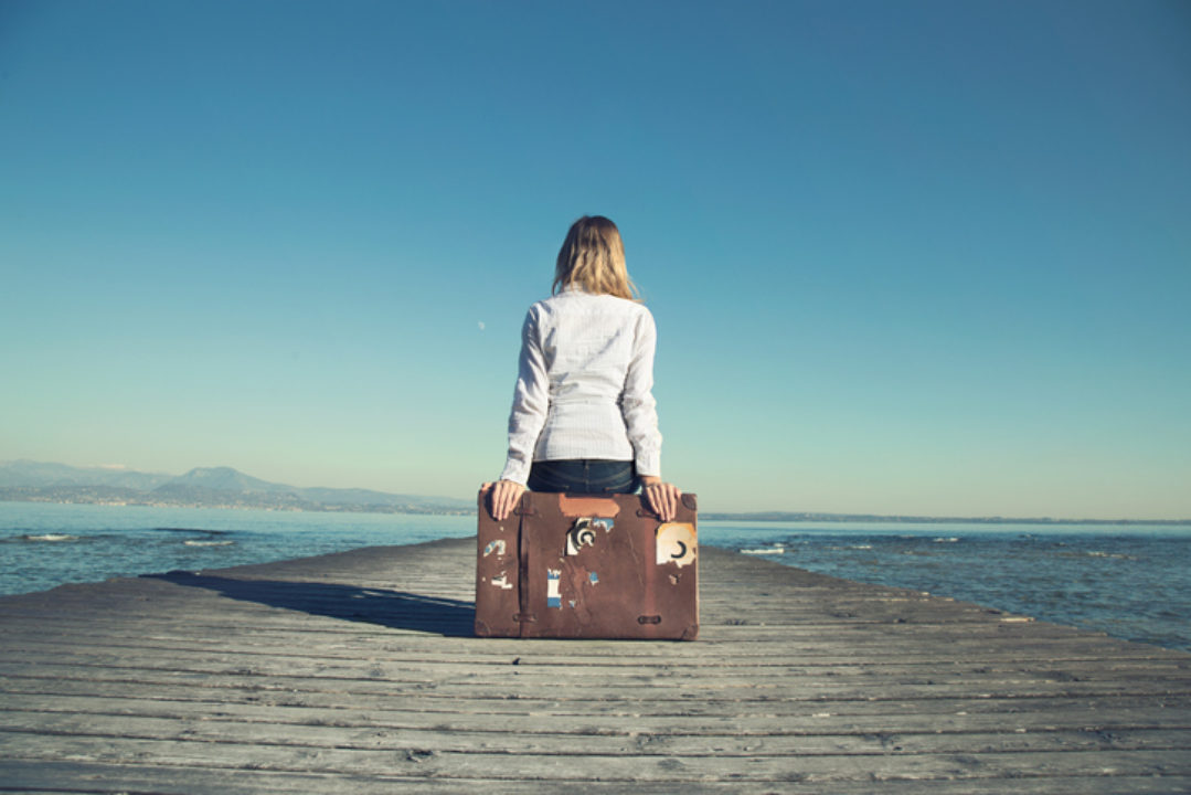 "<img src=""Woman on Suitcase with Pier"" alt=""Woman contemplating leaving""/>"