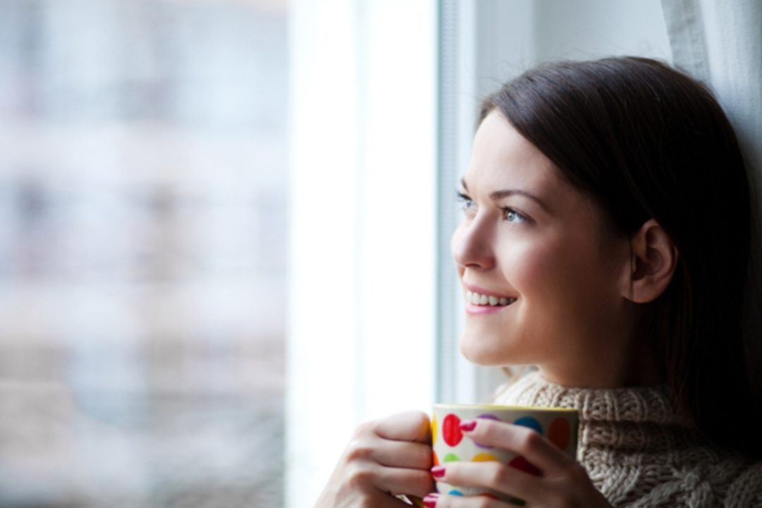 Woman smiling with coffee