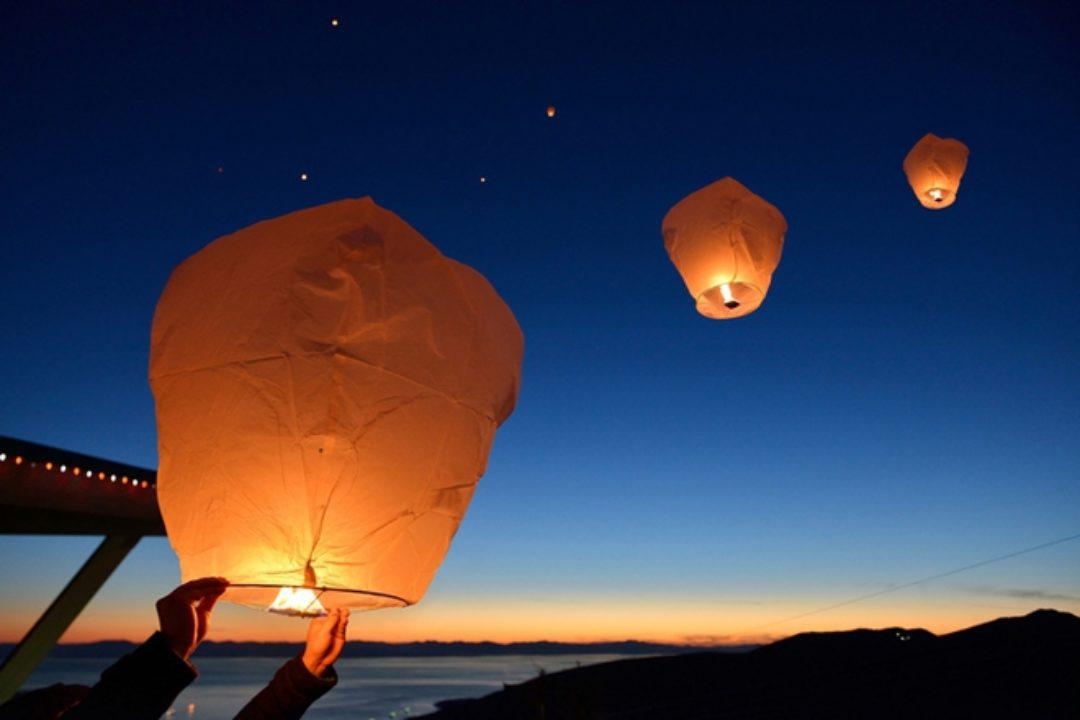 paper lanterns against dark sky