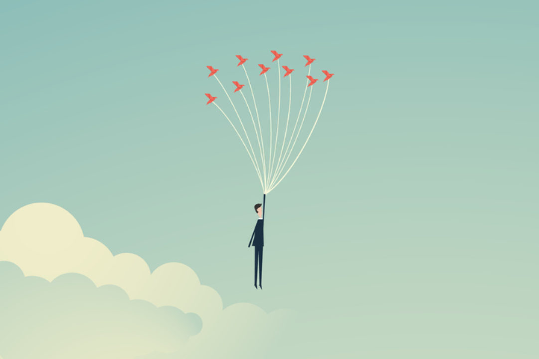 An illustration of a man lifted by bird-like balloons into the sky, signifying hope.