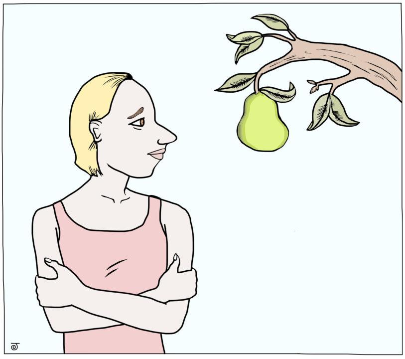 A women glances at a pear tree