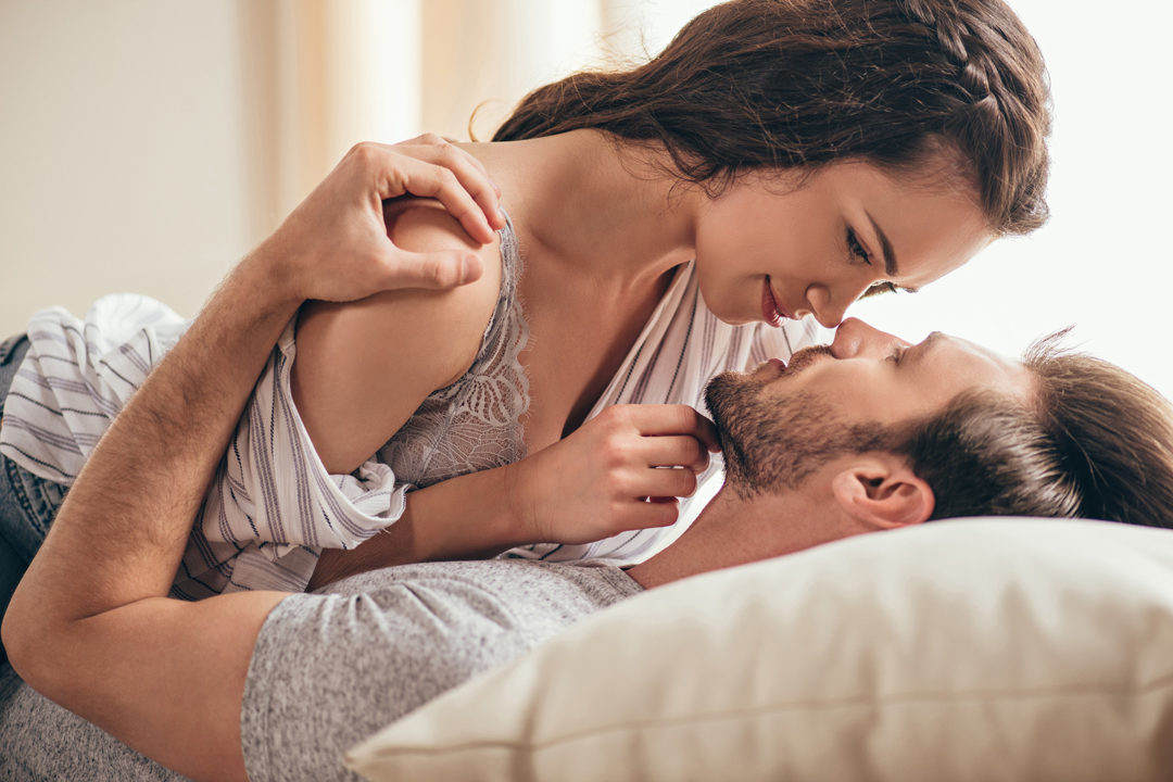 Woman and man intimate together