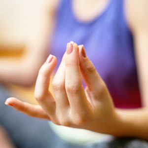 Woman's hands while meditating