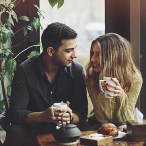 Caring couple at coffee shop