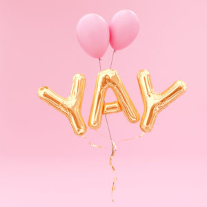 Mylar balloons spelling Yay!