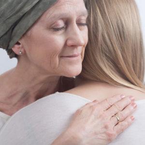 Caregiver and patient hugging