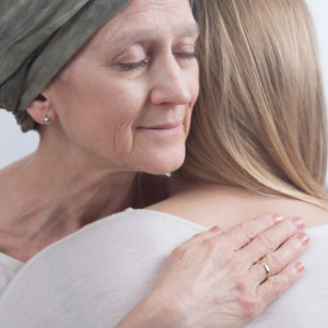 Caregiver and patient hugging