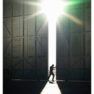 Man pushing open door