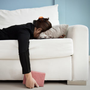 Exhausted woman on couch