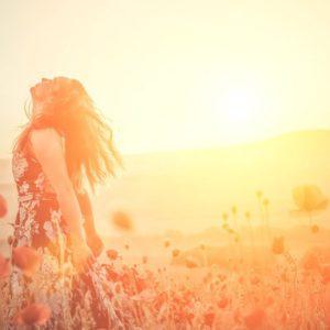 Woman embracing sunlight