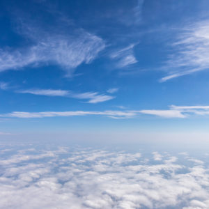 High above the clouds, a blue sky.