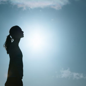 Woman looking toward sky