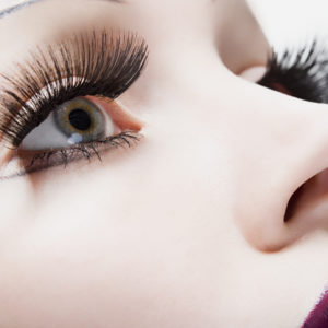 A woman with large fake eyelashes