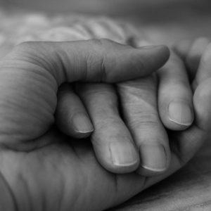 "<img src=""hands.jpg"" alt=""hand holding to offer comfort""/>"