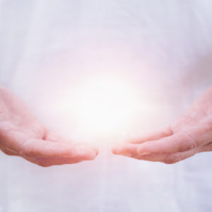 Hands with a healing white light