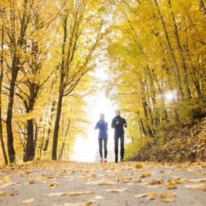 Couple running in fall