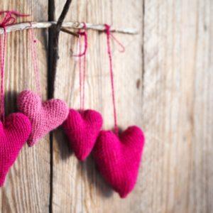 Crocheted hearts on wood wall