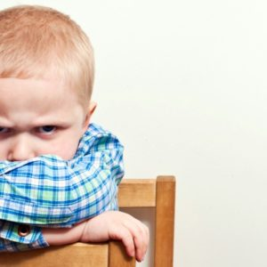Angry young child in chair