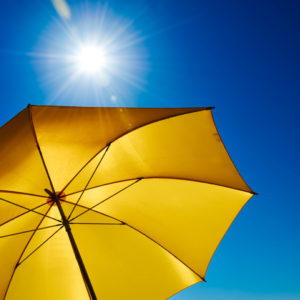 A sunny umbrella on the beach.