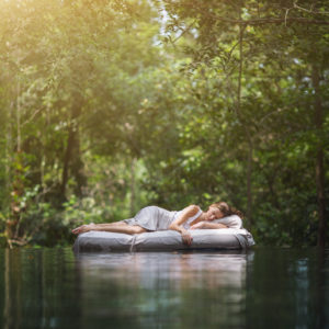 Woman resting in jungle
