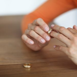 Woman taking ring off finger
