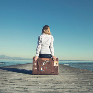 """<img src=""""Woman on Suitcase with Pier"""" alt=""""Woman contemplating leaving""""/>"""