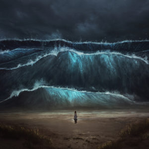 Woman on the beach facing tidal waves