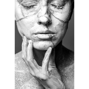 woman's face with clay