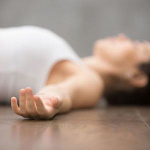 Woman relaxing in savasana