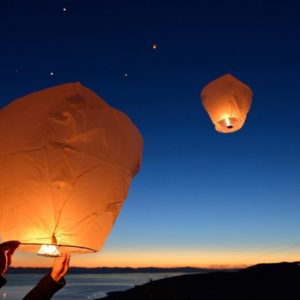 paper lanterns against dark sky