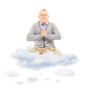 A man levitates on a cloud