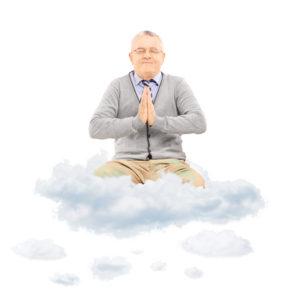 A man levitates on a cloud