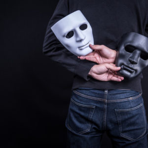 holding two masks