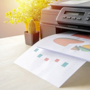 printer printing out pages with graphs on them