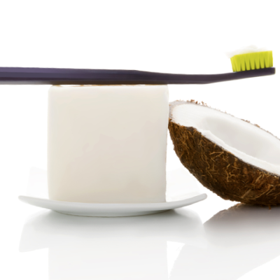 toothbrush and coconut for Ayurvedic oil pulling