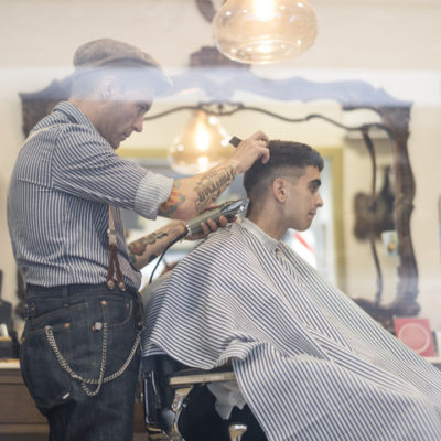 man getting haircut at barber shop