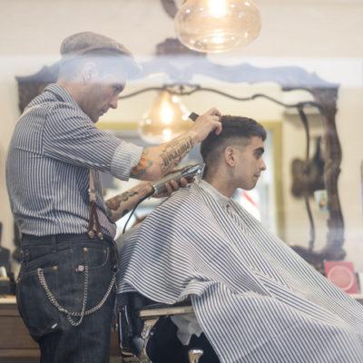 man getting haircut at barber shop