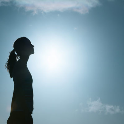 Woman looking toward sky