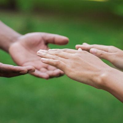 Helping hands reaching.